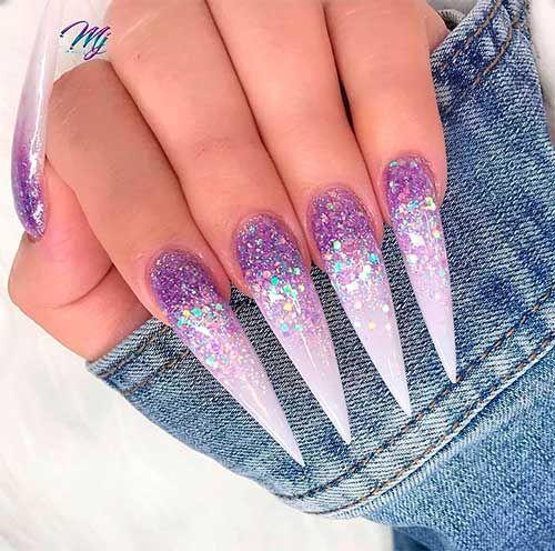 Purple ombre nails in acrylic stiletto shape with glitter