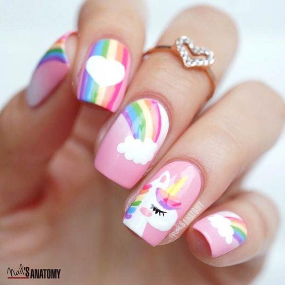 Pink and rainbow unicorn nail art