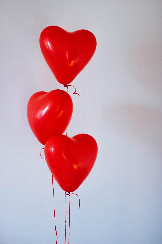 Red heart balloons aesthetic