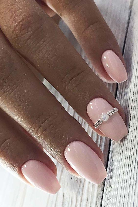 Short light pink bridal nails with ring
