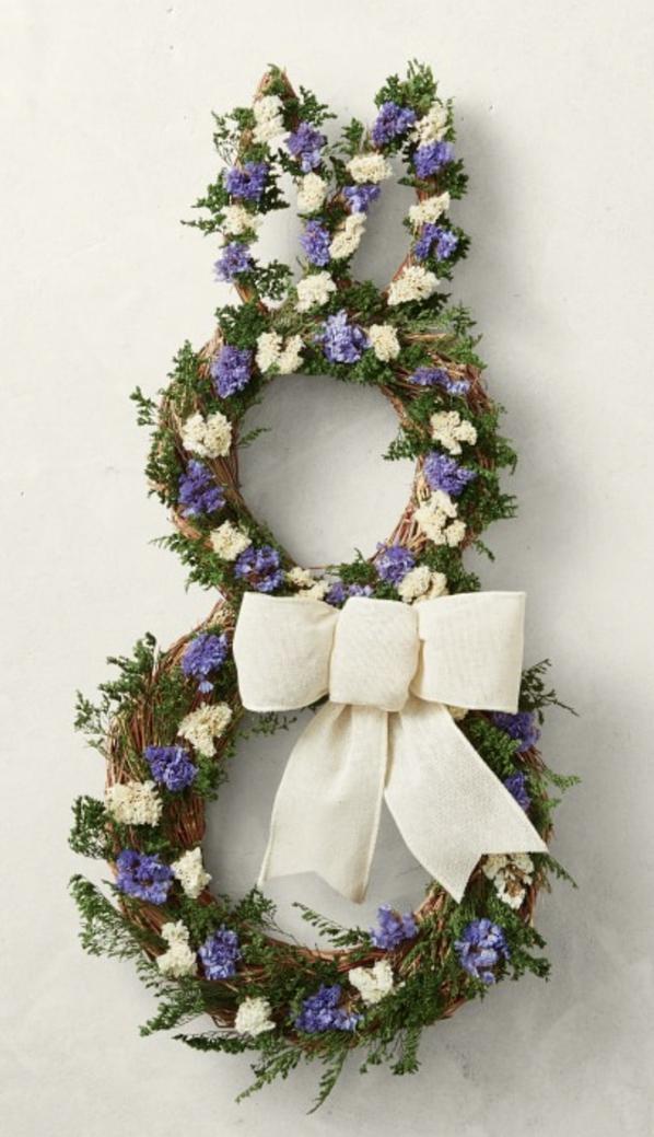 Elegant bunny wreath with ribbon