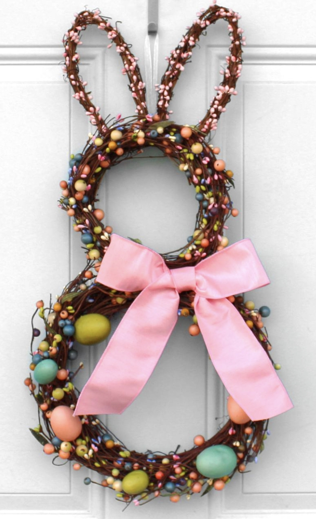Pink bunny wreath with ribbon and eggs