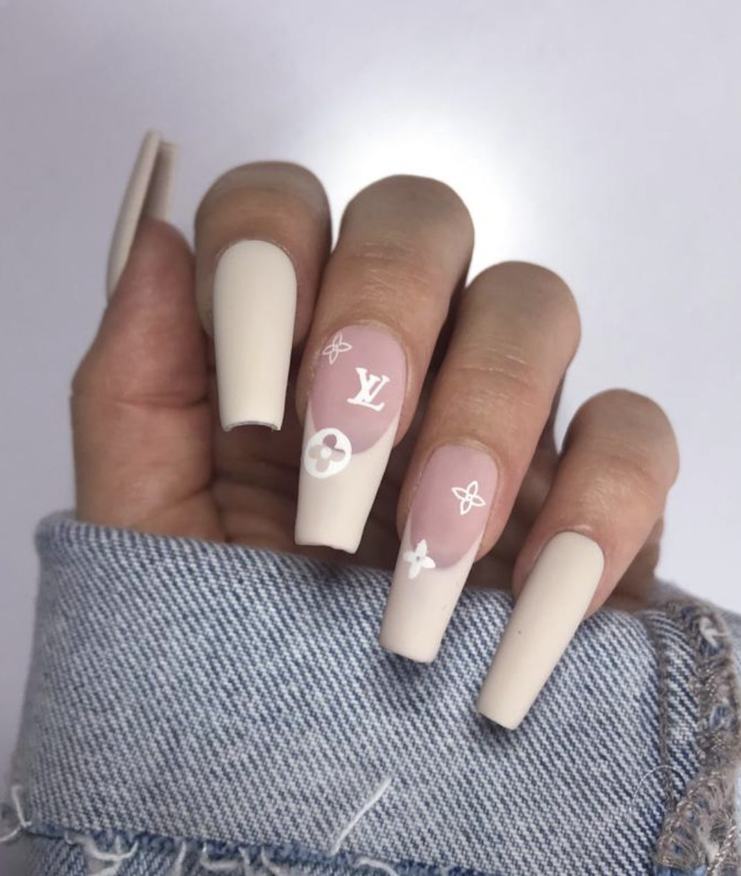 Nude Louis Vuitton inspired French tip nails