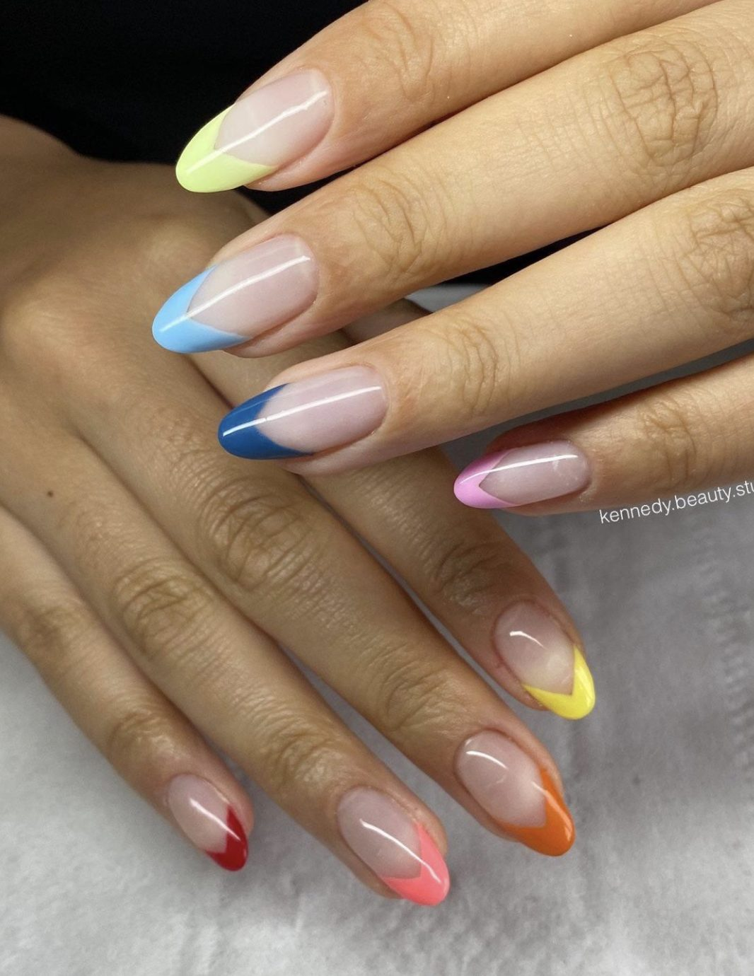 Pastel rainbow French tip nails