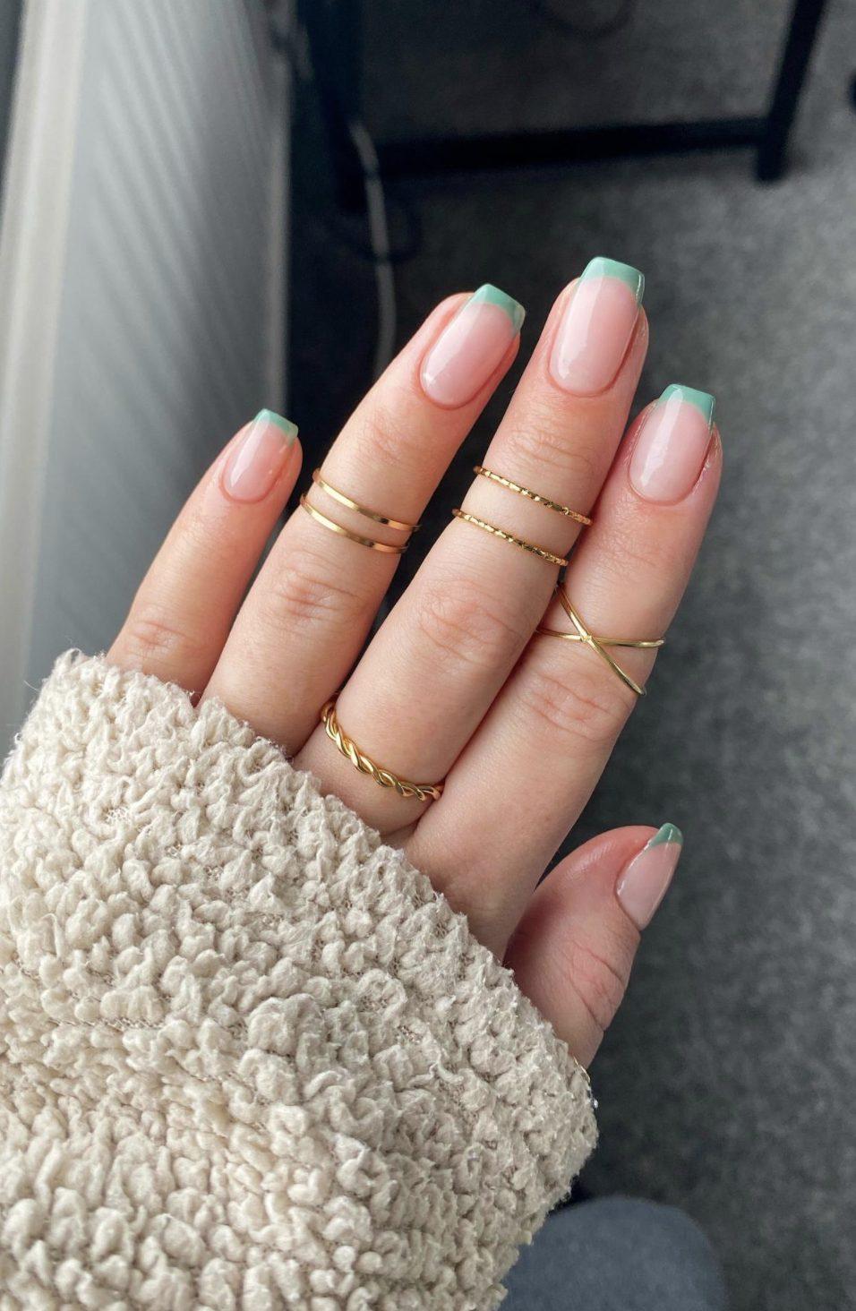 Short sage green French tip nails