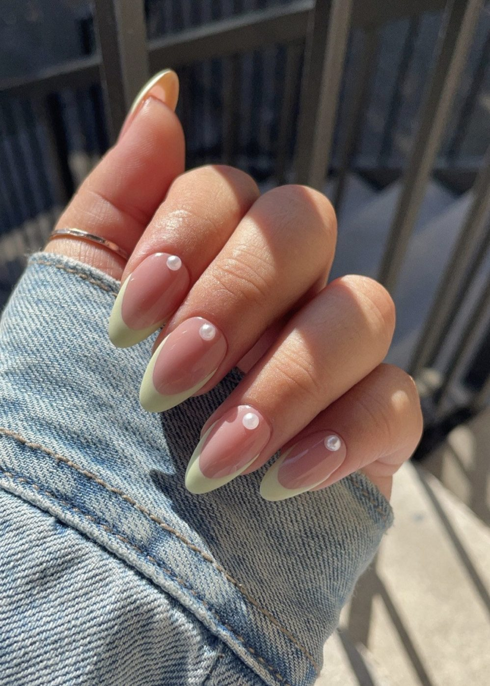 Sage green French tip nails in almond shape