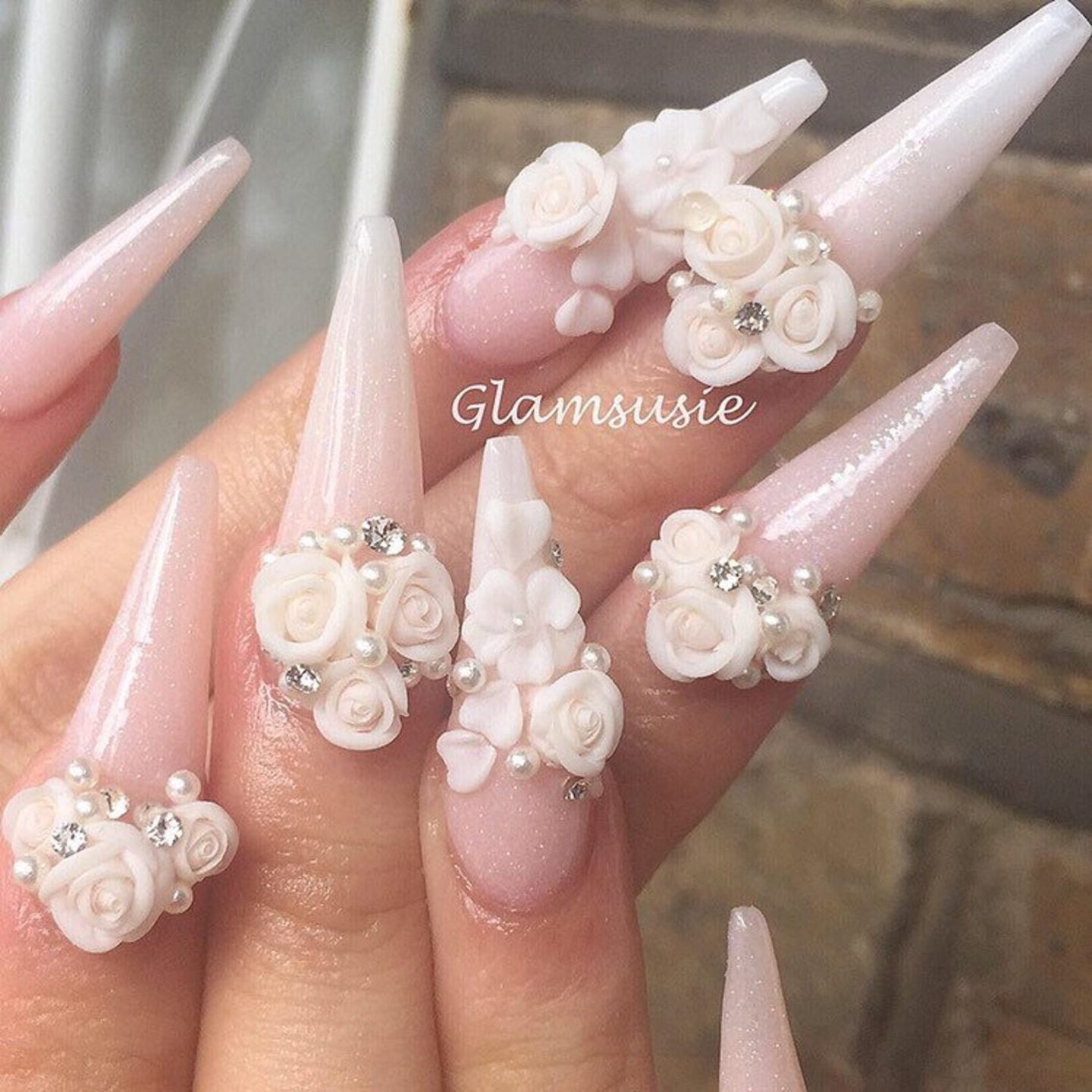 Glamorous white wedding nails with roses and flowers