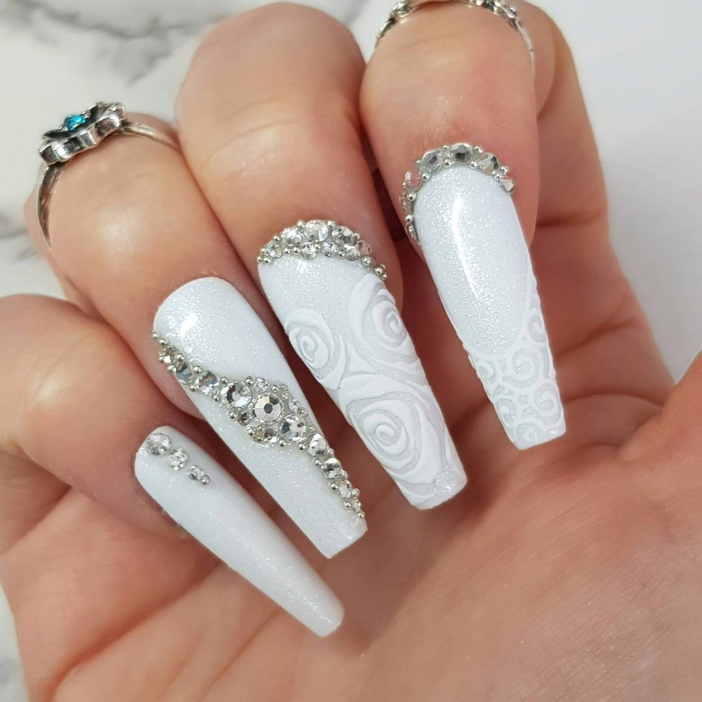 Long white wedding nails with lace nail art, glitter and rhinestones