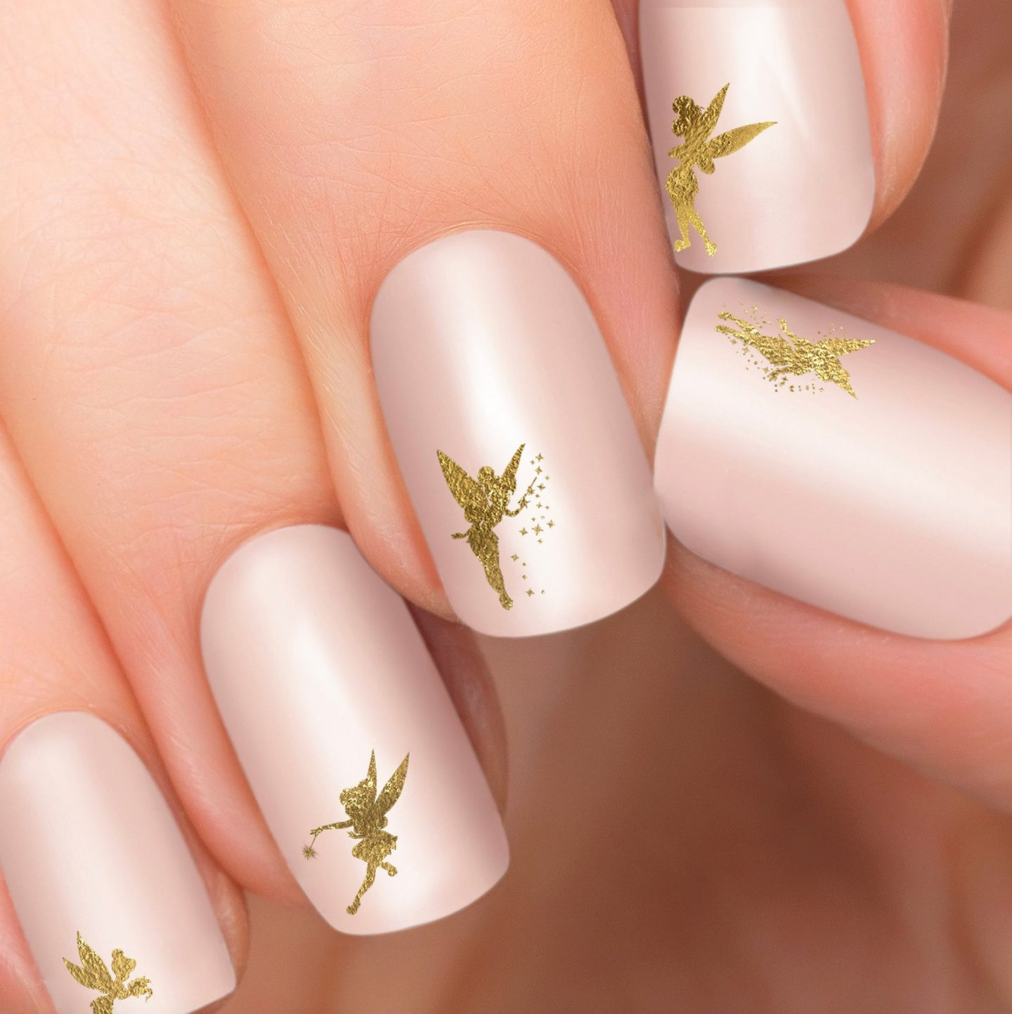 Light pink and gold Tinkerbell nails