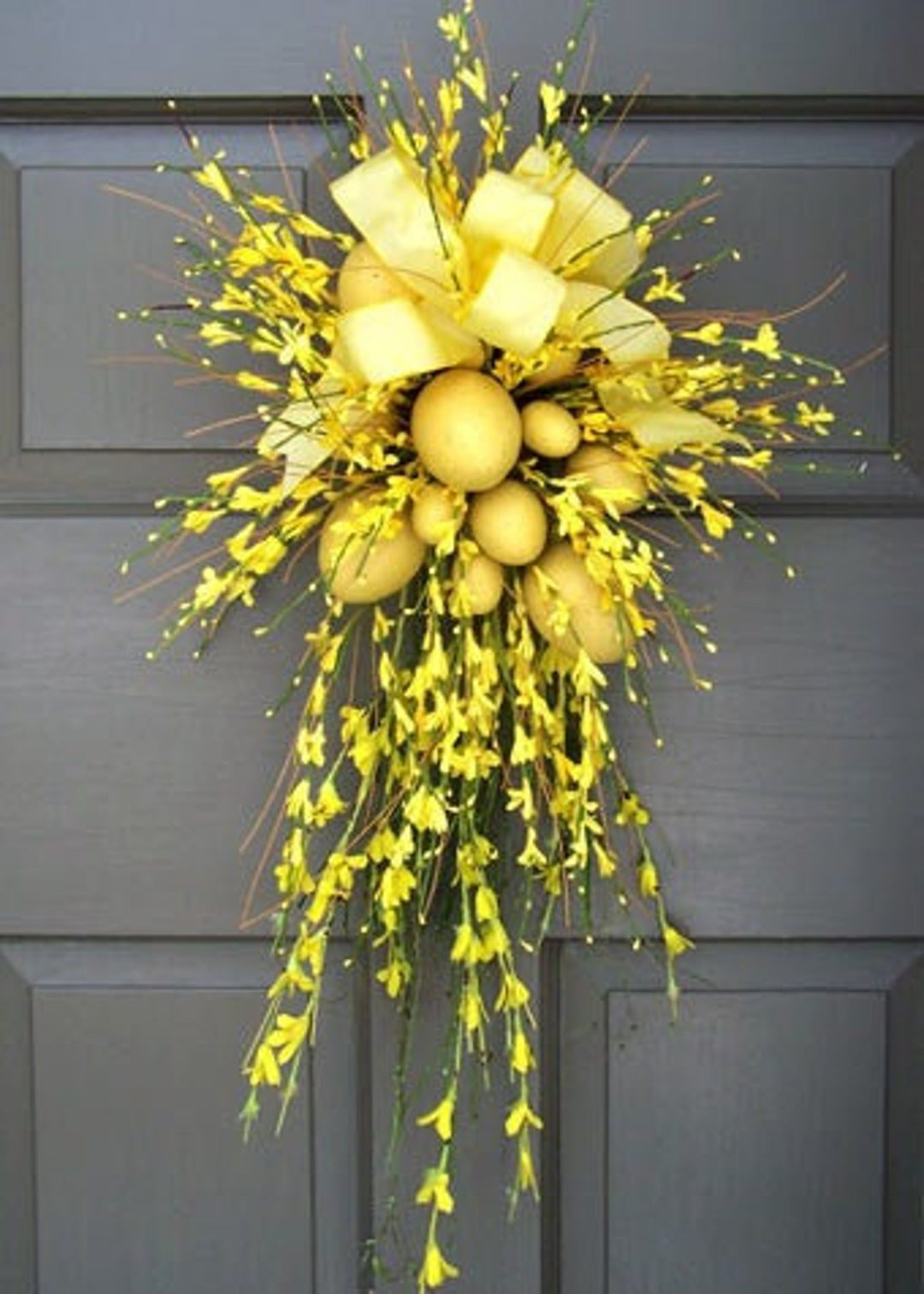 Yellow Easter wreath with eggs and flowers