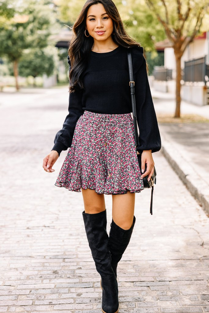 Cute fall outfit with black sweater, floral skirt and black knee high boots