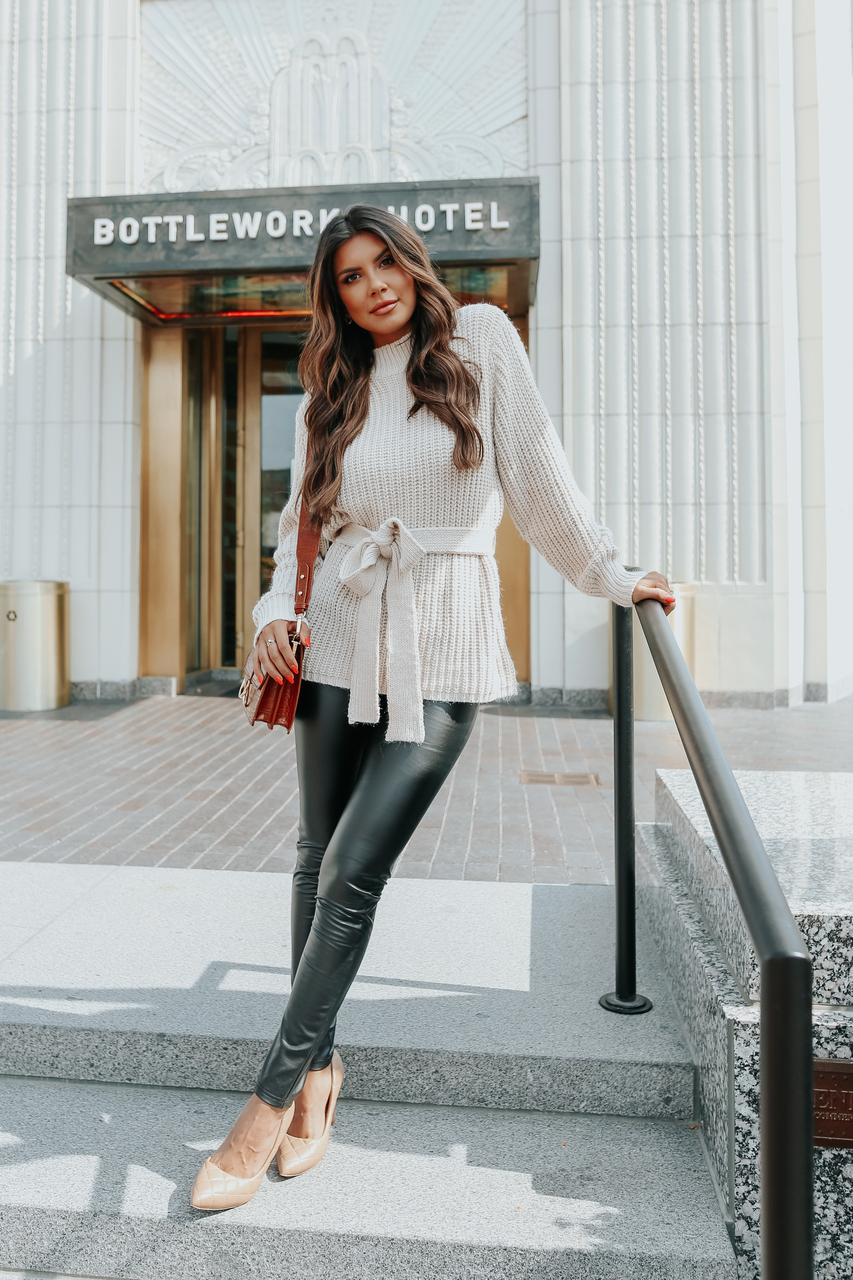 Cute fall outfits with faux leather leggings and cream knit sweater with belt