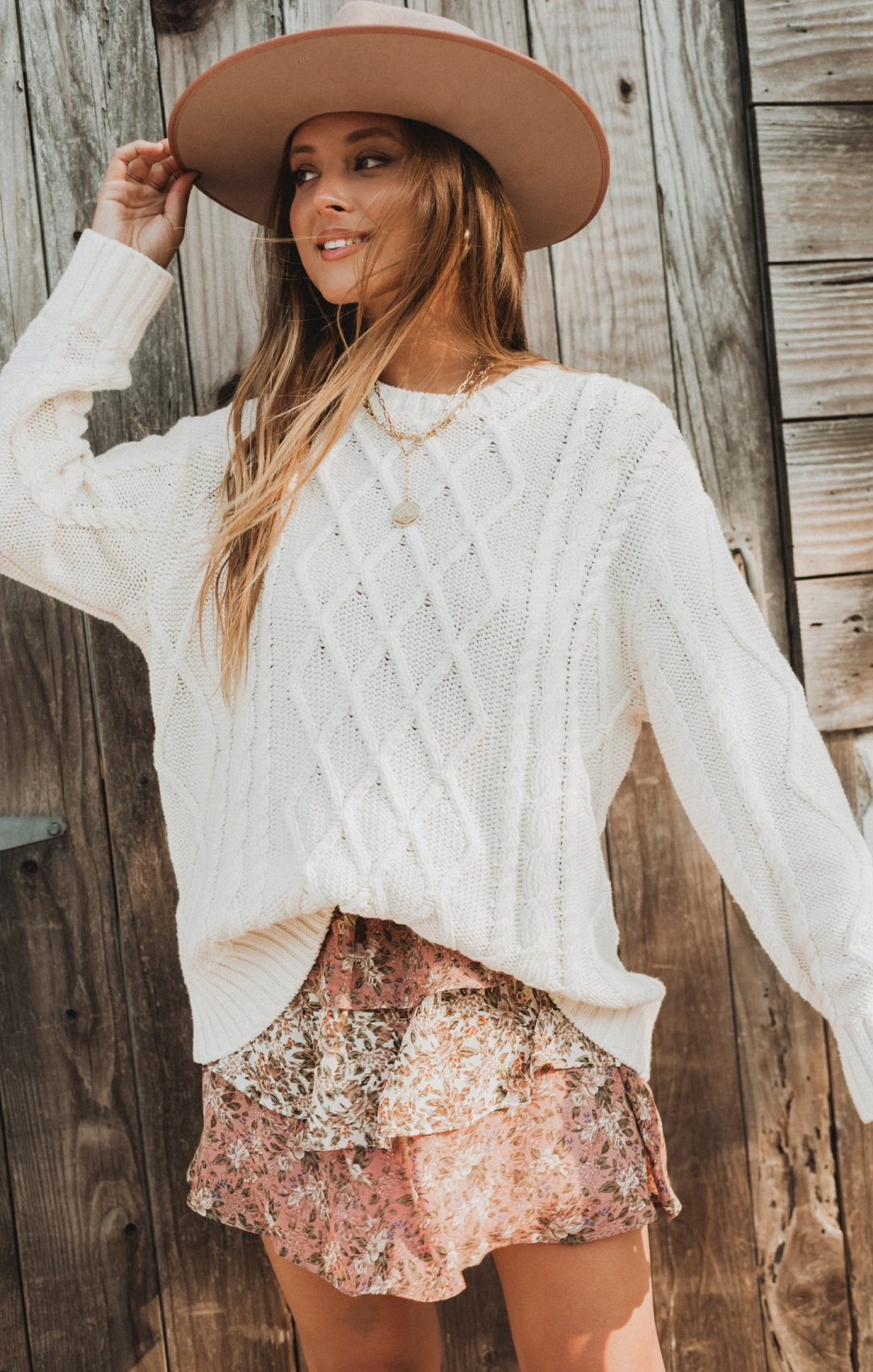 Cute fall outfit with white sweater and floral skirt