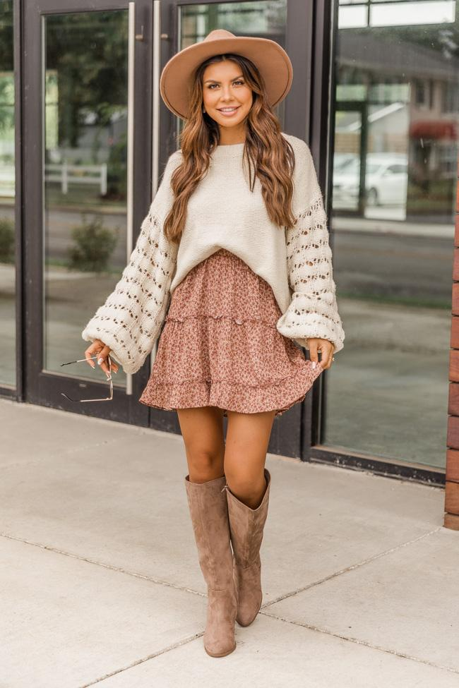 Cute fall outfit with sweater, skirt and knee high boots