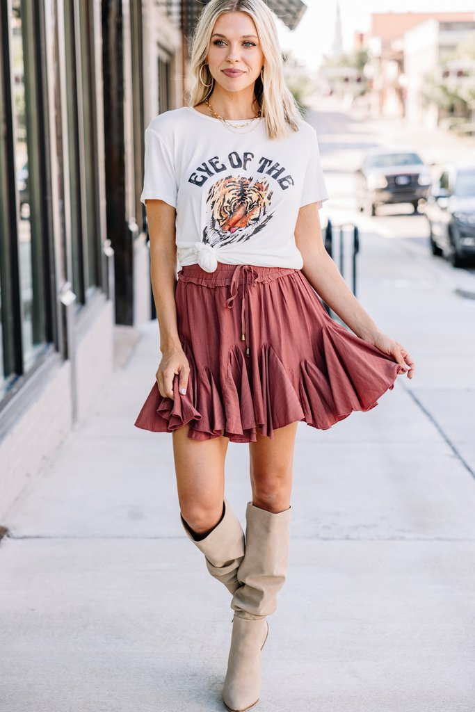 Cute fall outfit with burnt orange skirt and graphic tee
