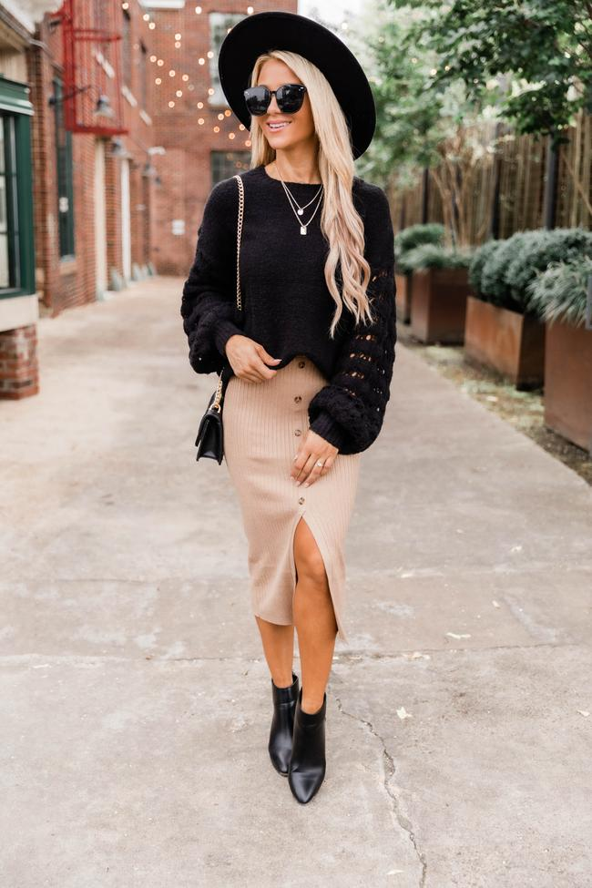 Cute fall outfit with beige midi skirt and black sweater