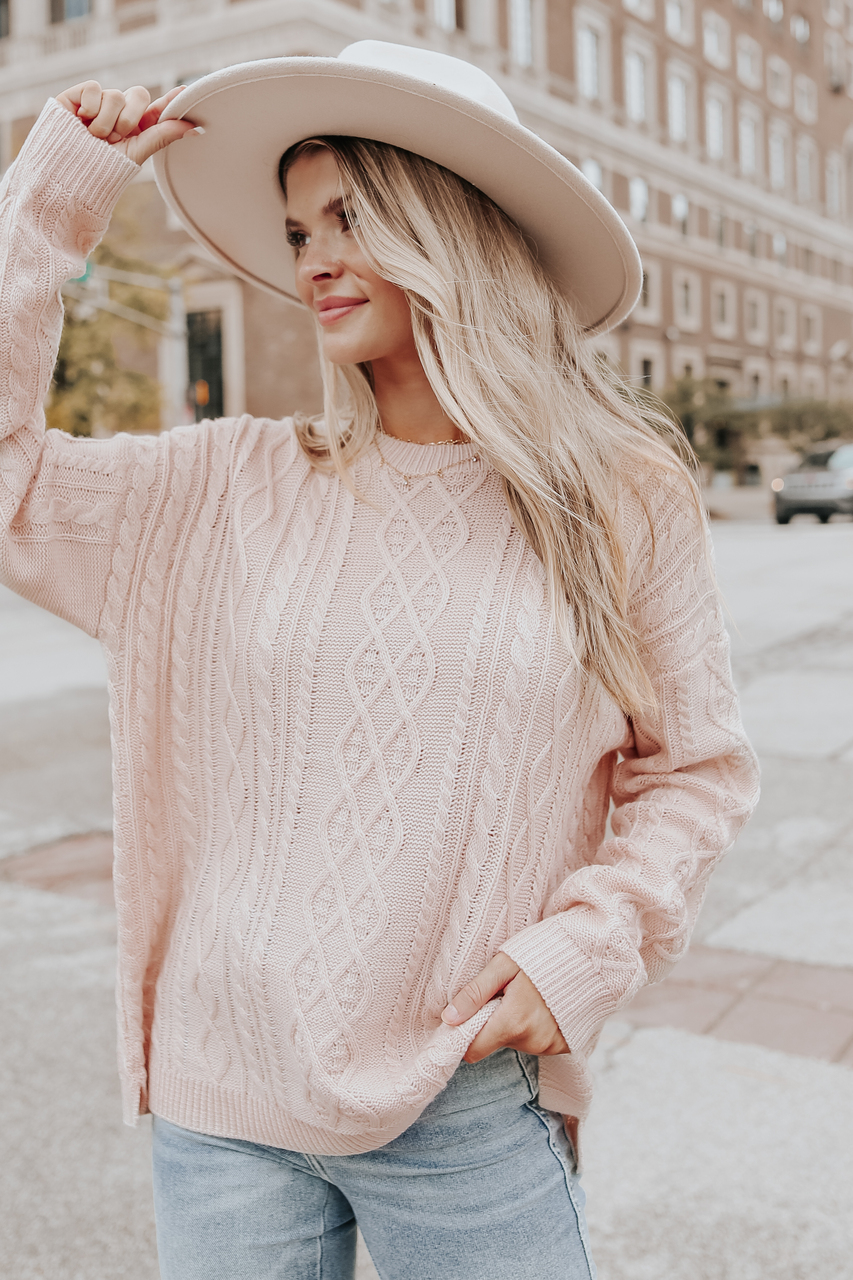 Cute light pink cable knit sweater