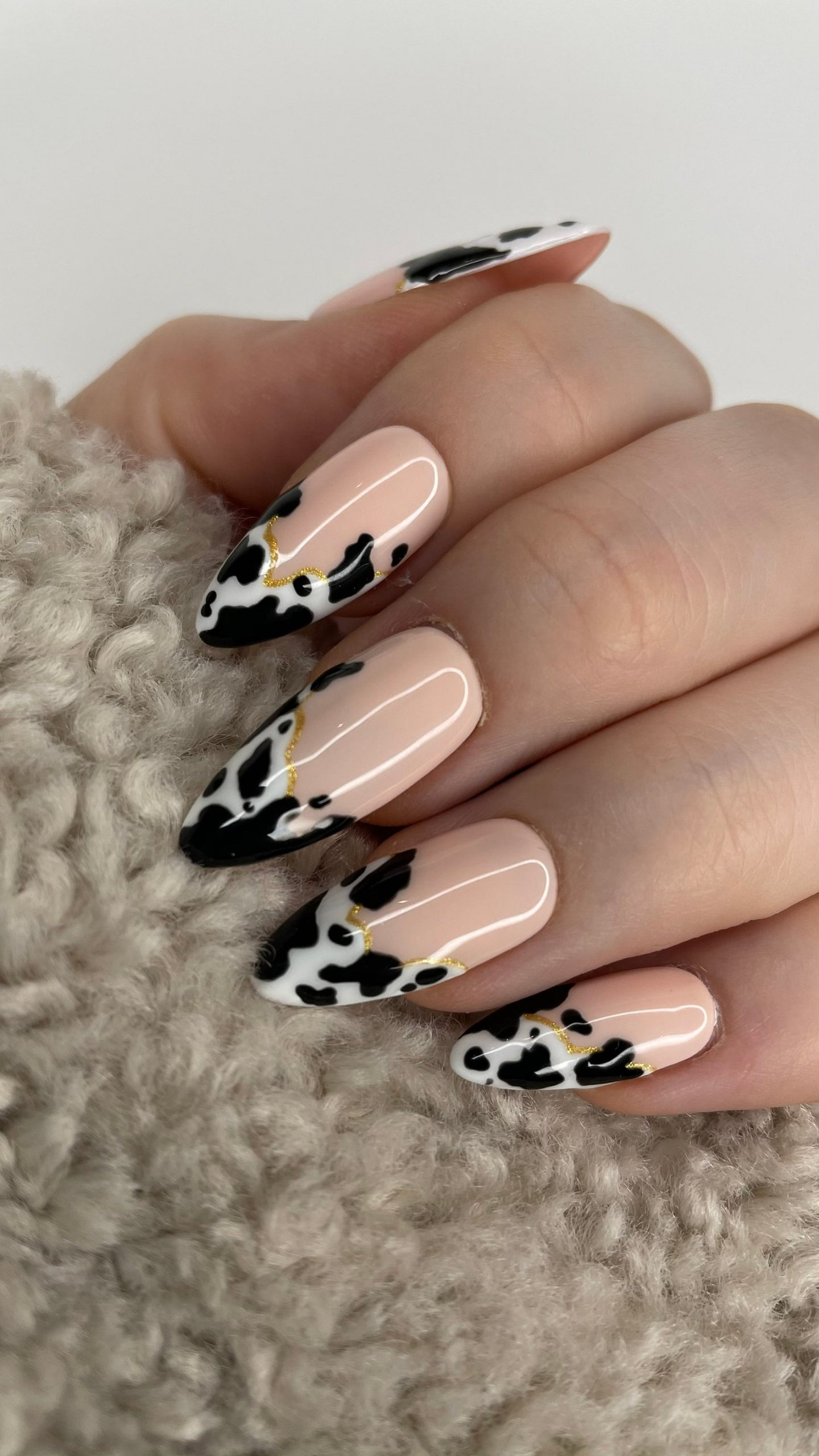 Cow print French tip nails
