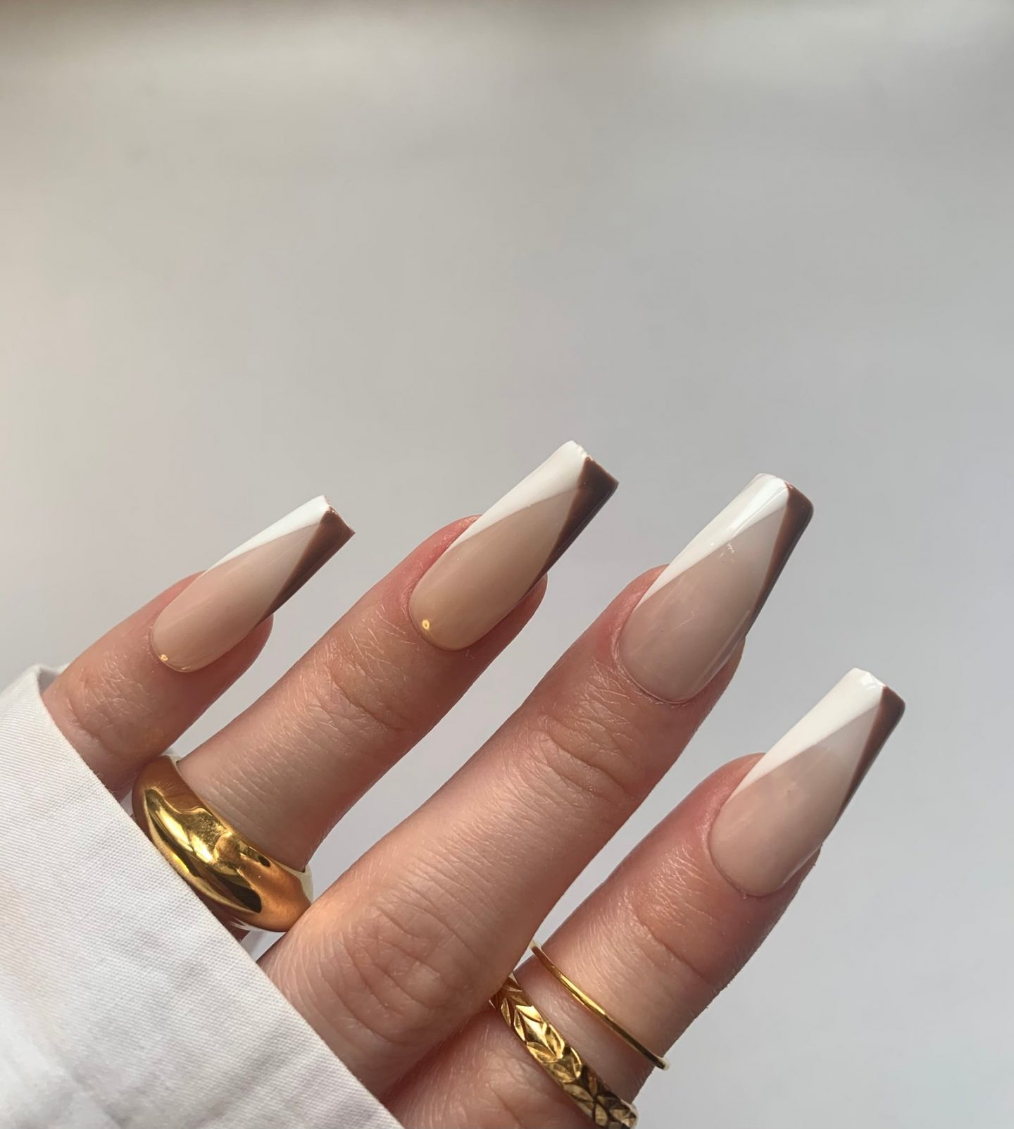 Brown and white French nails