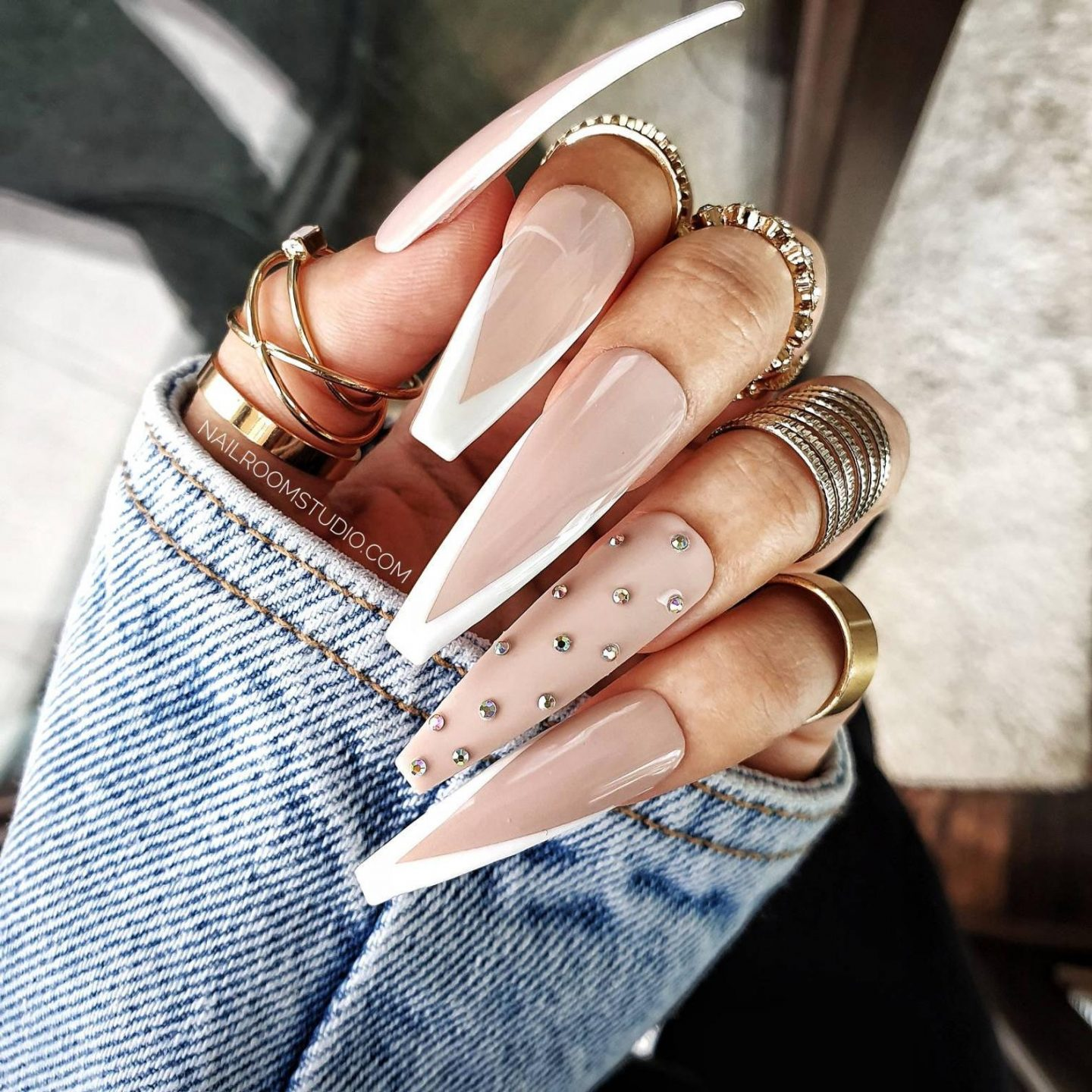 Long French tip coffin nails with rhinestones