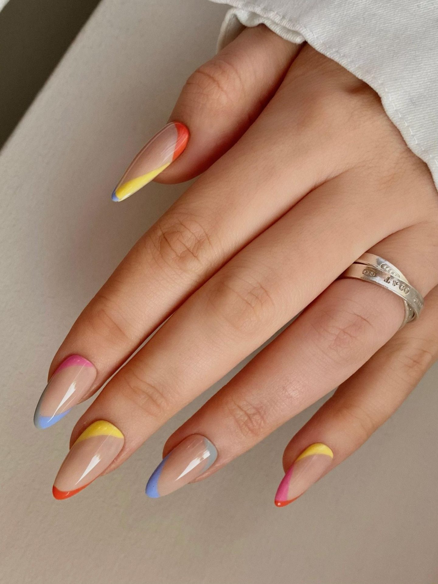 Abstract rainbow nails in almond shape