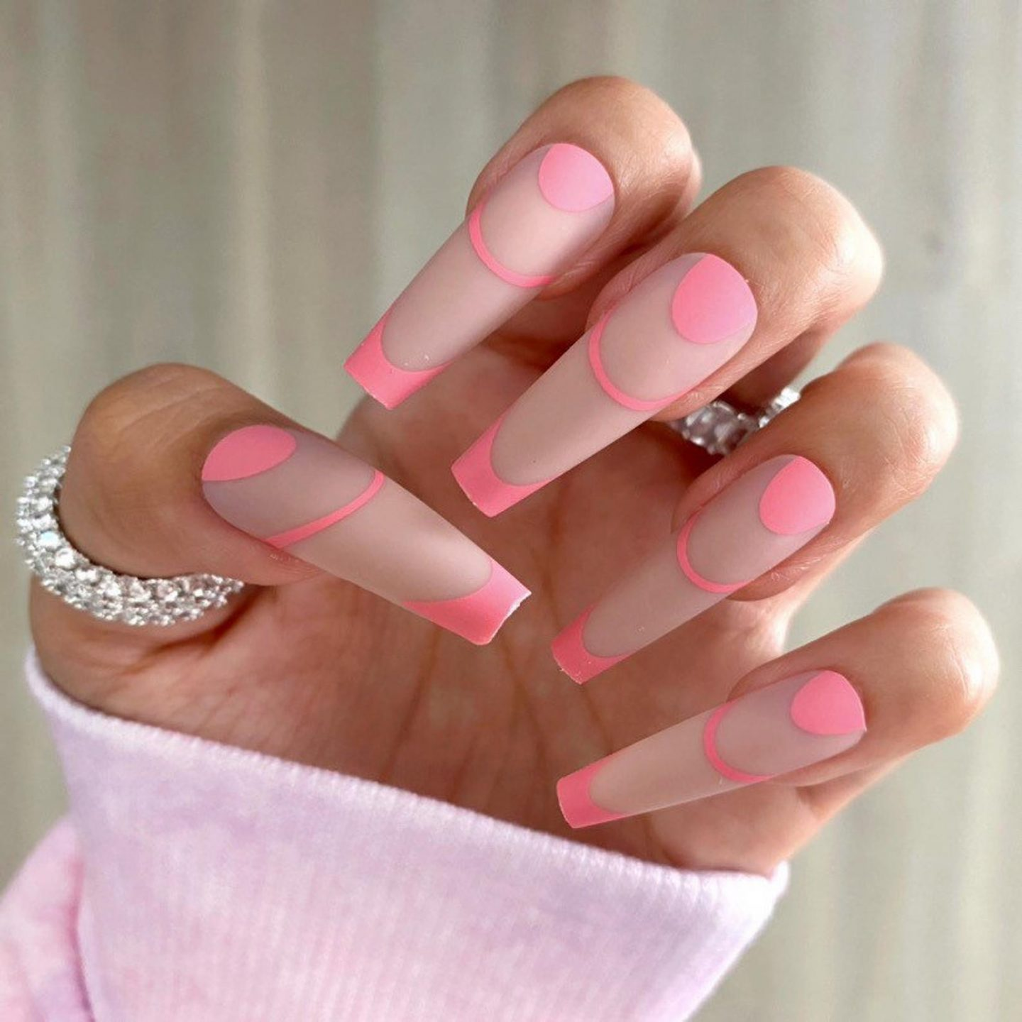 Minimalist nude and hot pink French tip nails