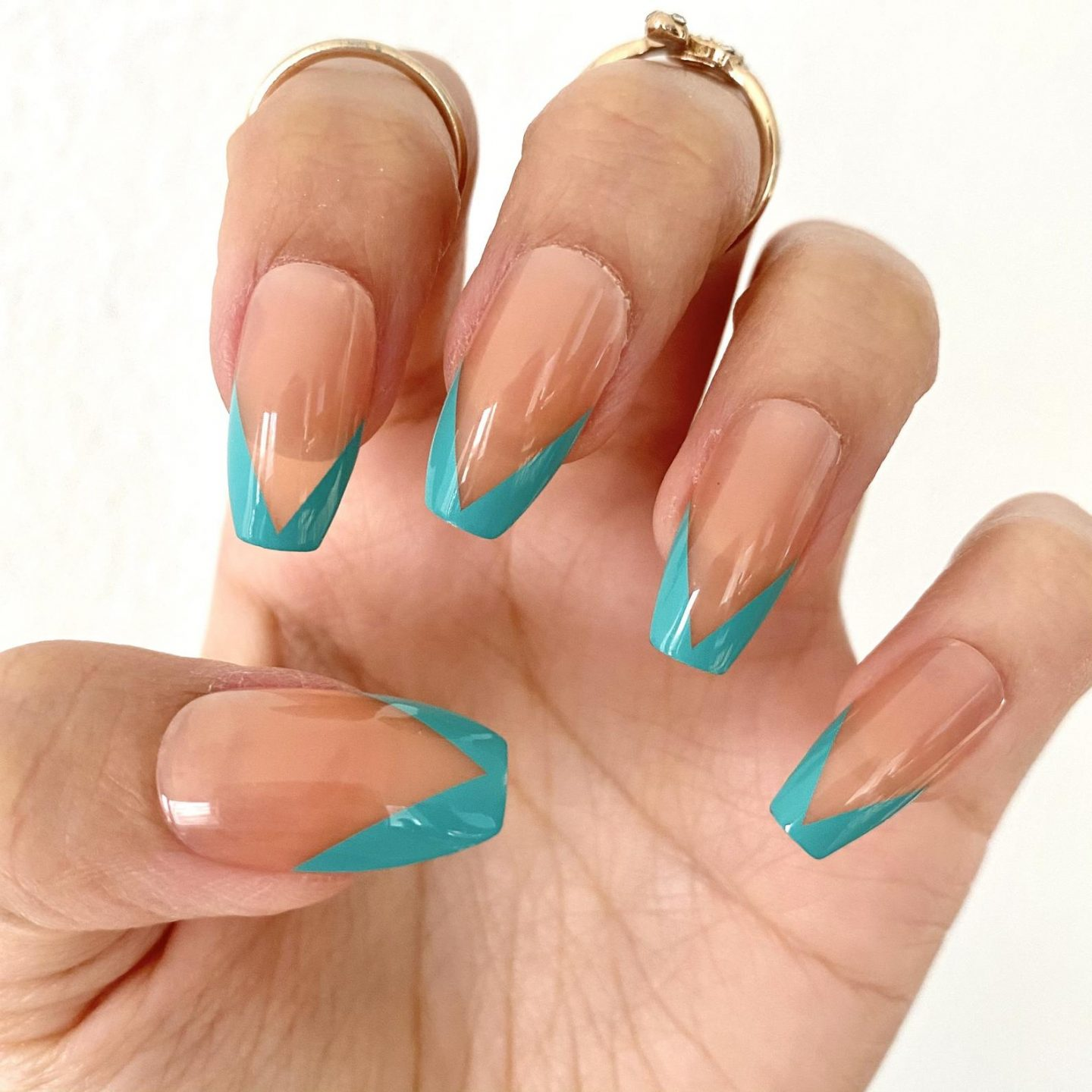 Teal French tip nails in coffin shape