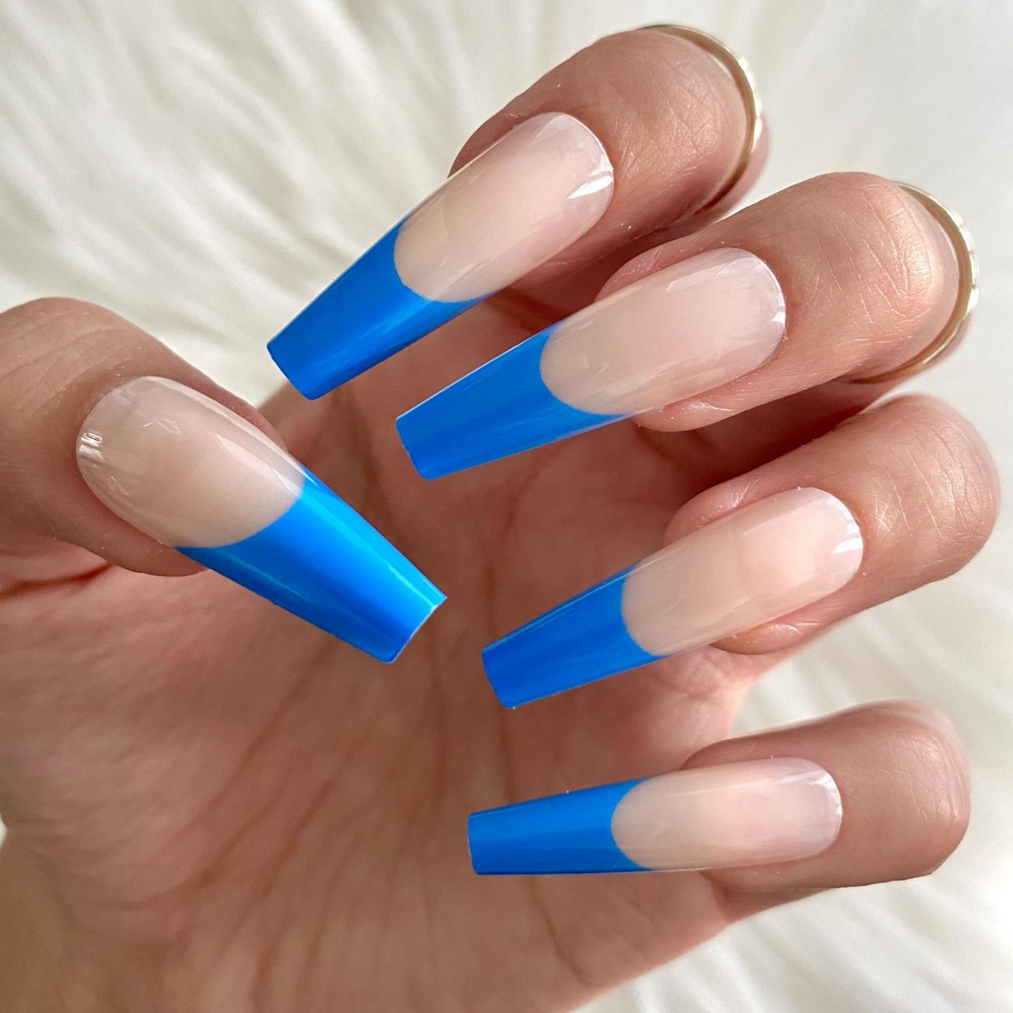 Long royal blue French tip coffin nails