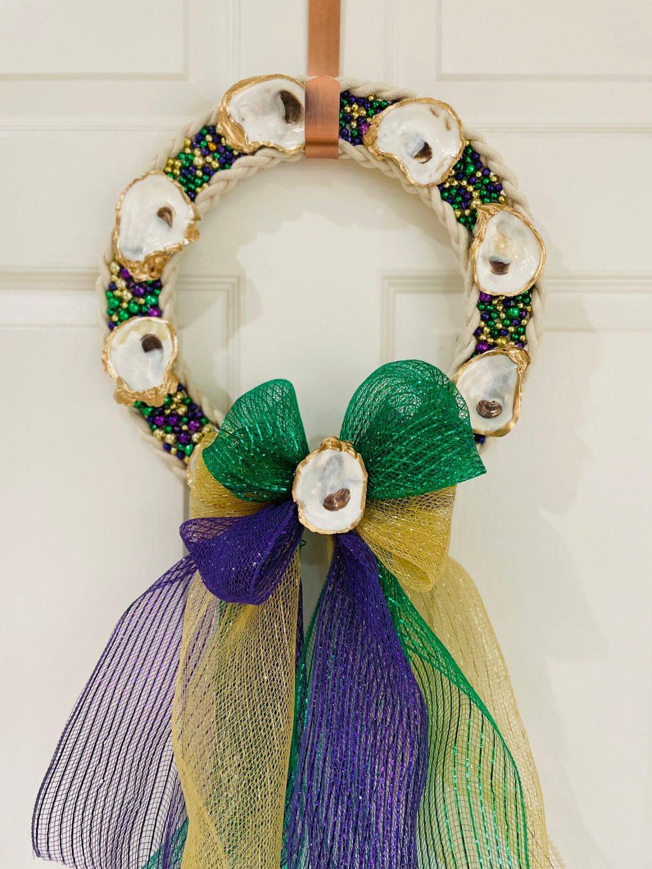 Mardi Gras wreath with ribbon and seashells
