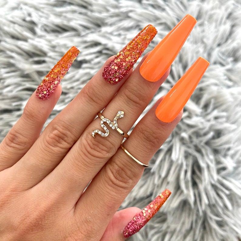 Long Neon Orange & Glitter Spring Coffin Nails