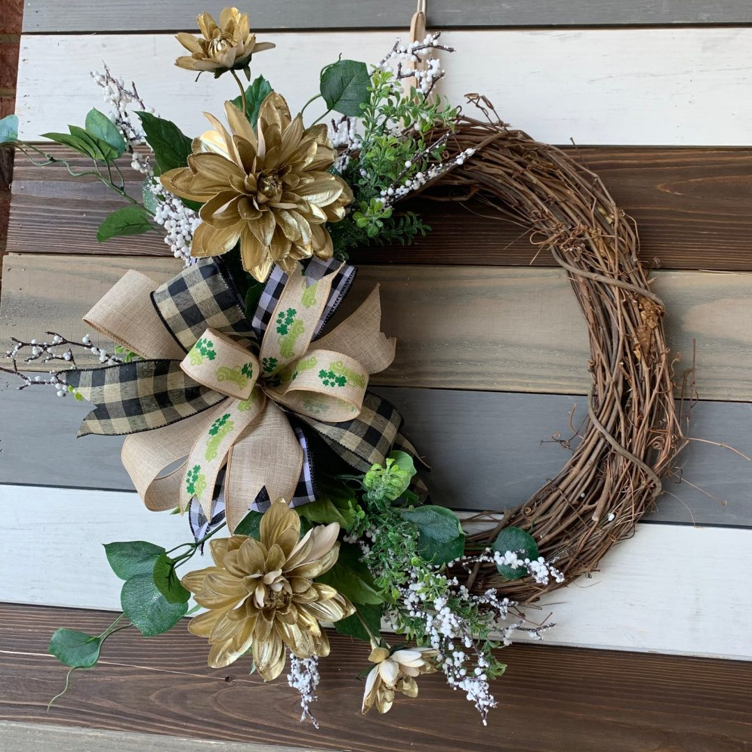 Green and gold grapevine wreath with ribbon