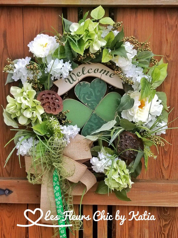 Green elegant spring wreath with flowers