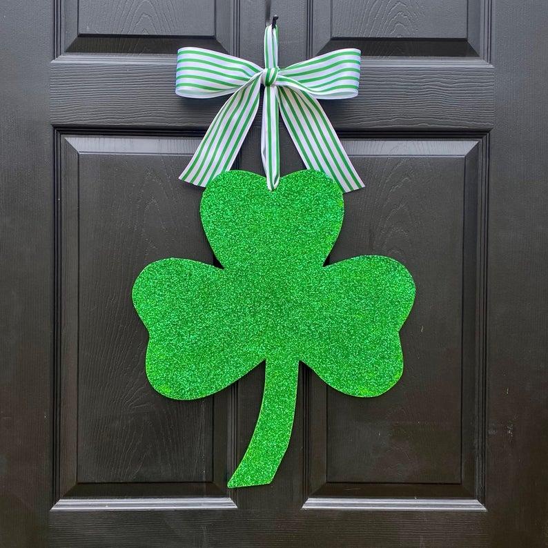 Cute shamrock door hanger with glitter - best St. Patrick's Day wreaths