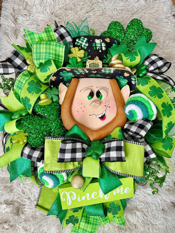 Green Irish wreaths with shamrock