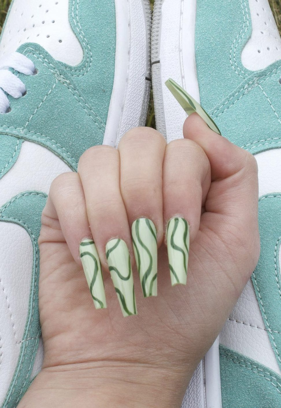 Sage green abstract nails with lines