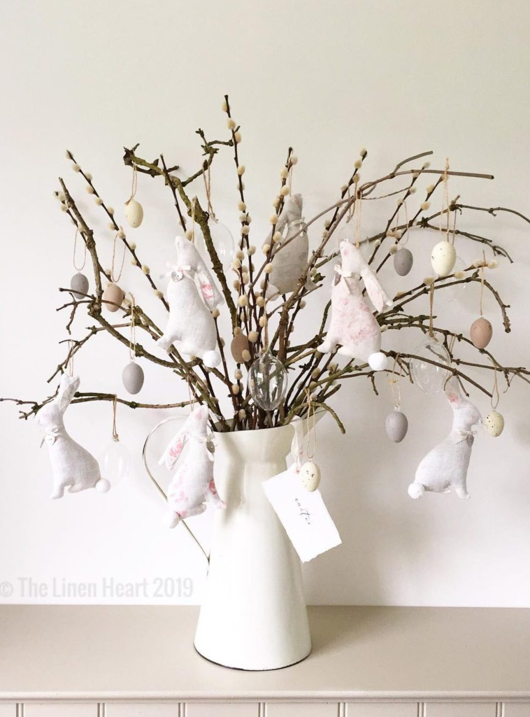 Pussy willow stems with Easter bunny decorations