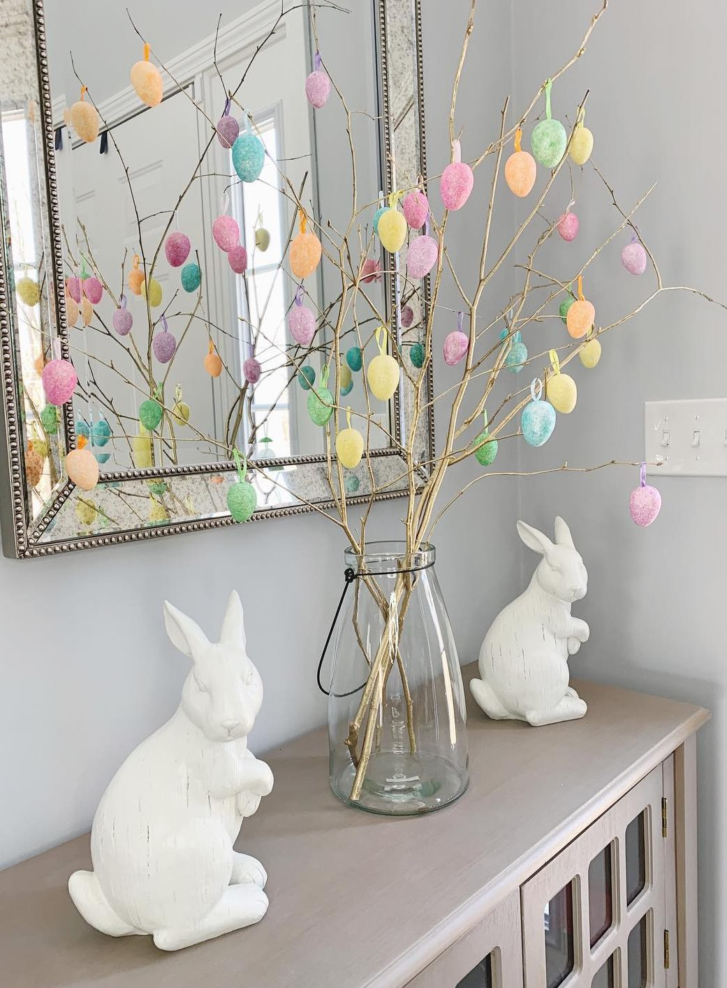 Gold Easter tree stems with colorful egg decorations