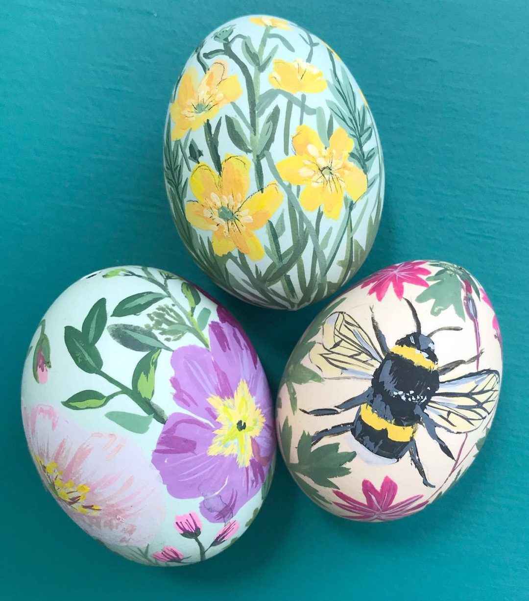 Creative Easter egg designs with bee and flowers