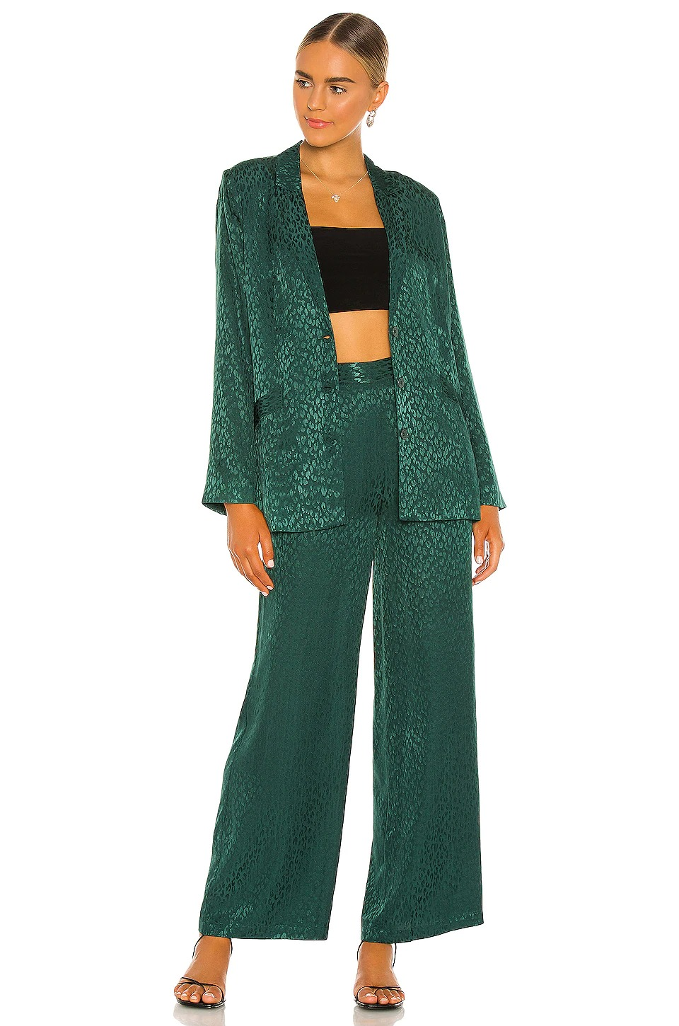 Green blazer and trouser suits for female wedding guests