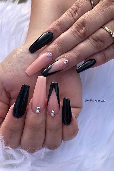 Nude and black French tip nails