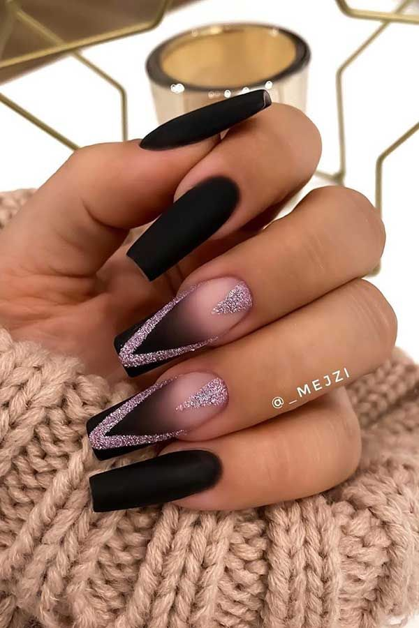 Matte black nails with silver glitter