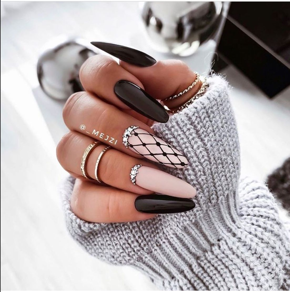 Pink and black nail art with fishnet effect