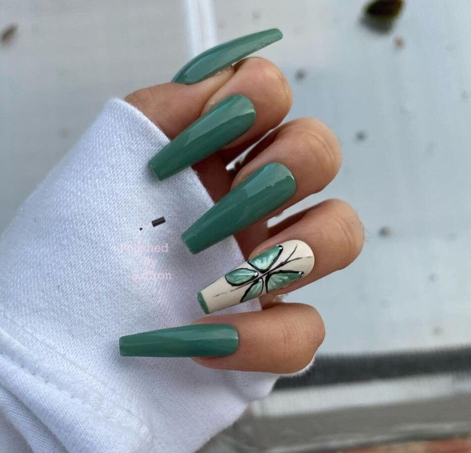 Green acrylic coffin nails with butterfly nail art