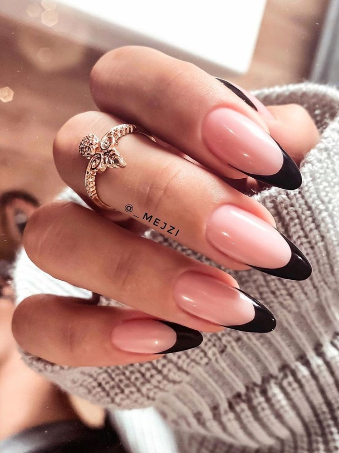 Almond black French tip nails