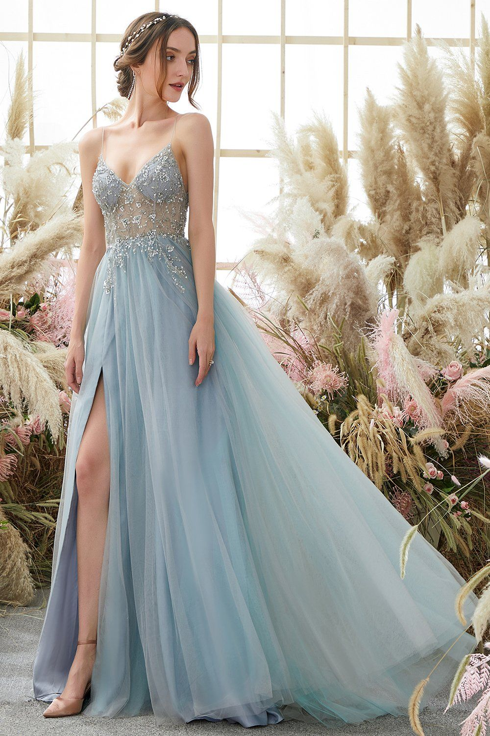Light blue beaded prom dress with slit and tulle train
