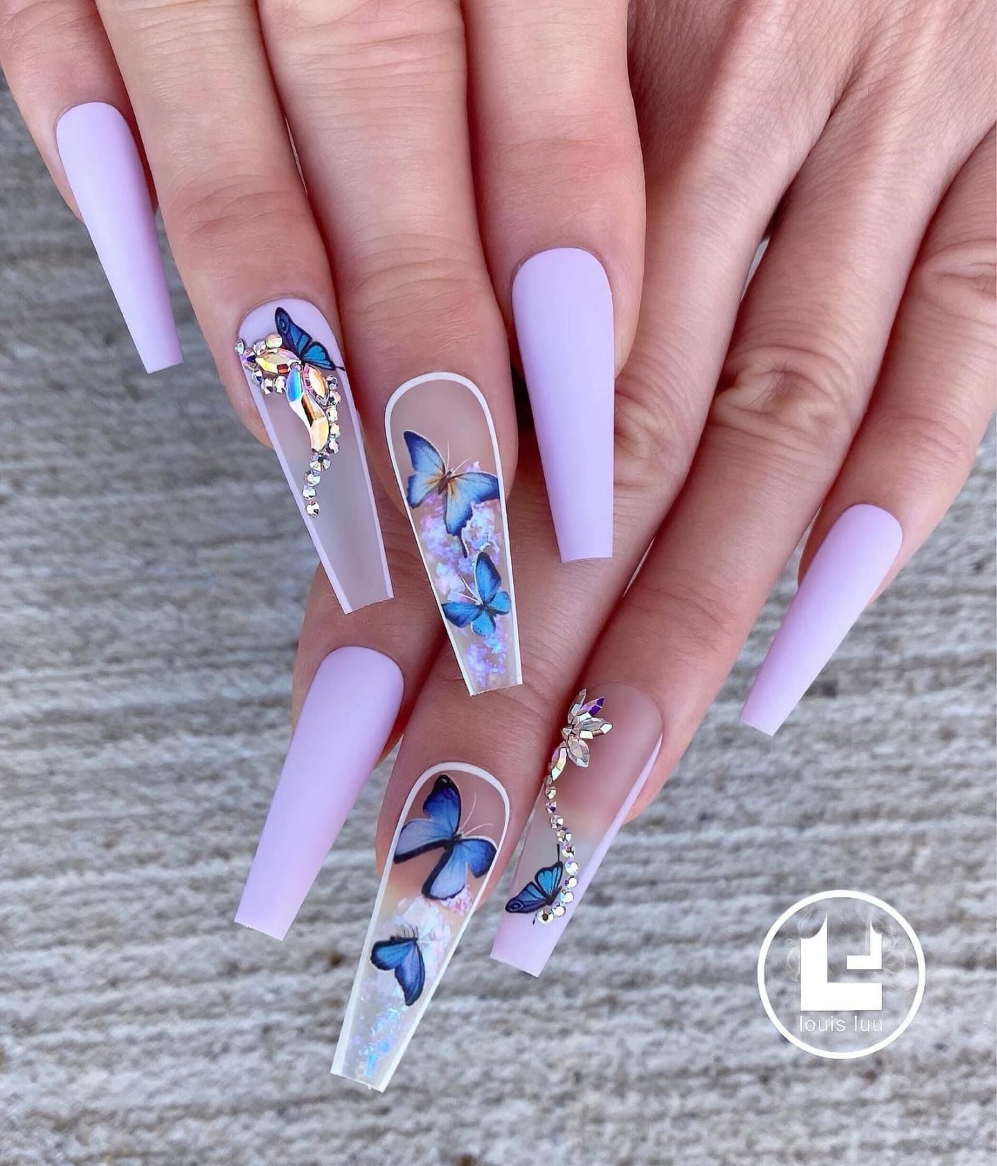 Matte pastel purple acrylic coffin nails with butterflies
