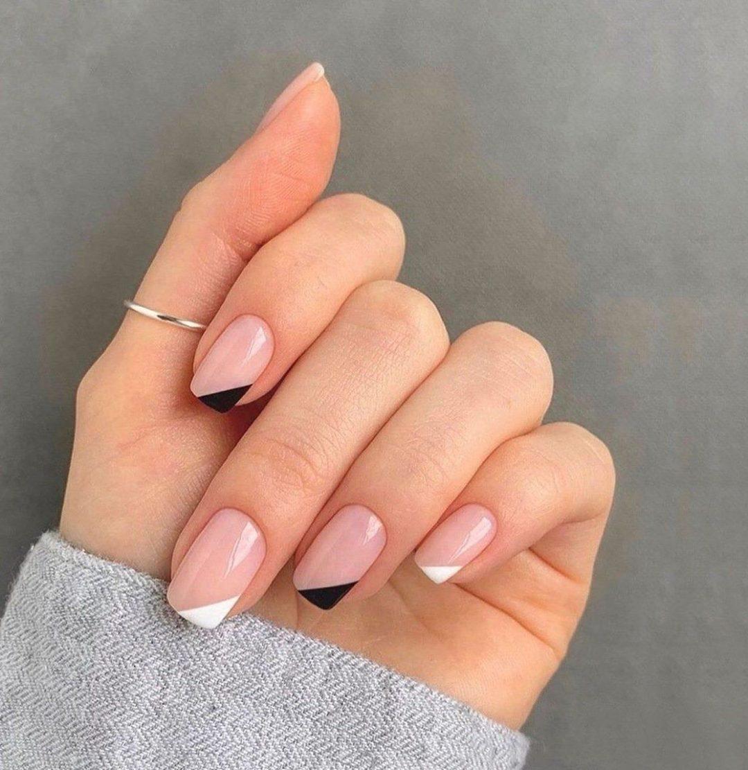 Black and white minimalist French tip nail art