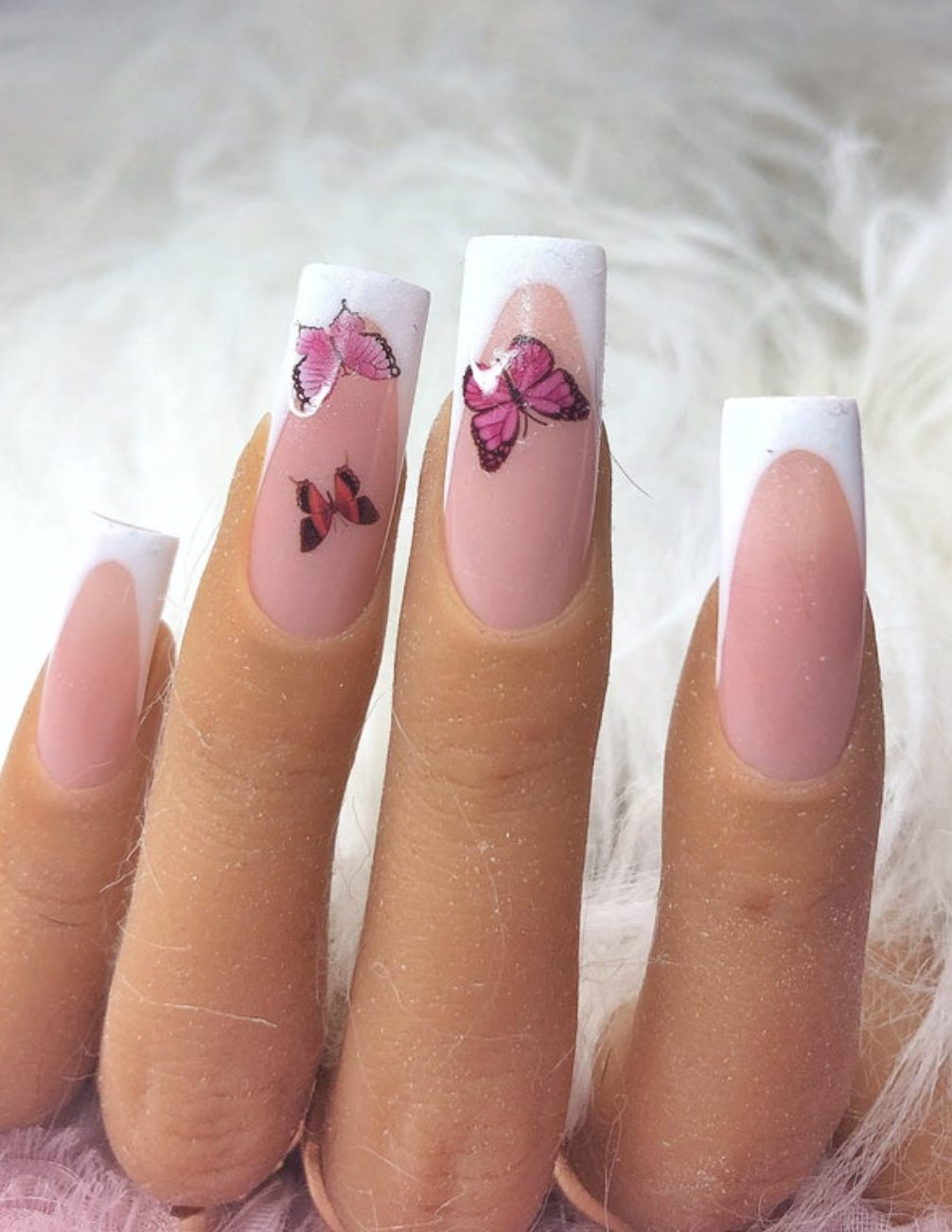 Elegant French tip nails with butterfly nail art