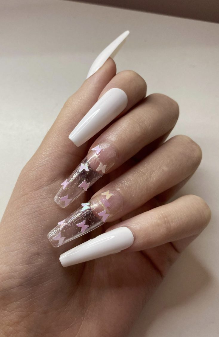 Transparent and white butterfly nails in coffin shape