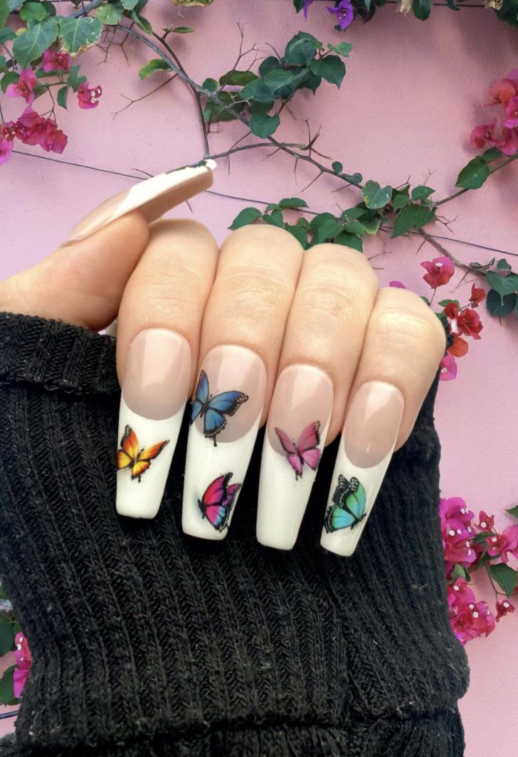 Long French tip nails with butterfly nail art